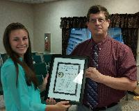 Sophia Parola, a JCP in Moscow Borough, is presented the Distinguished Junior Council Person Award from Joe Scott, PSAB.